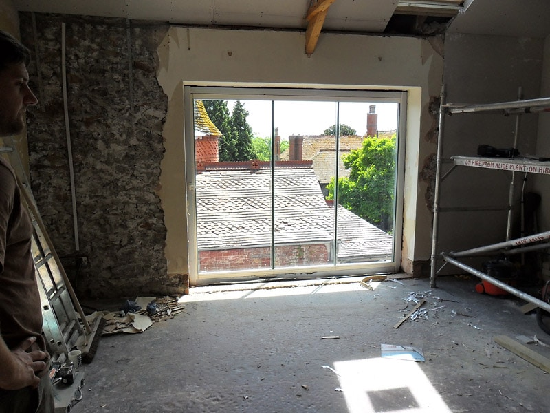 Bristol Slide Fold To Balcony Frameless Glass Bi Fold Doors