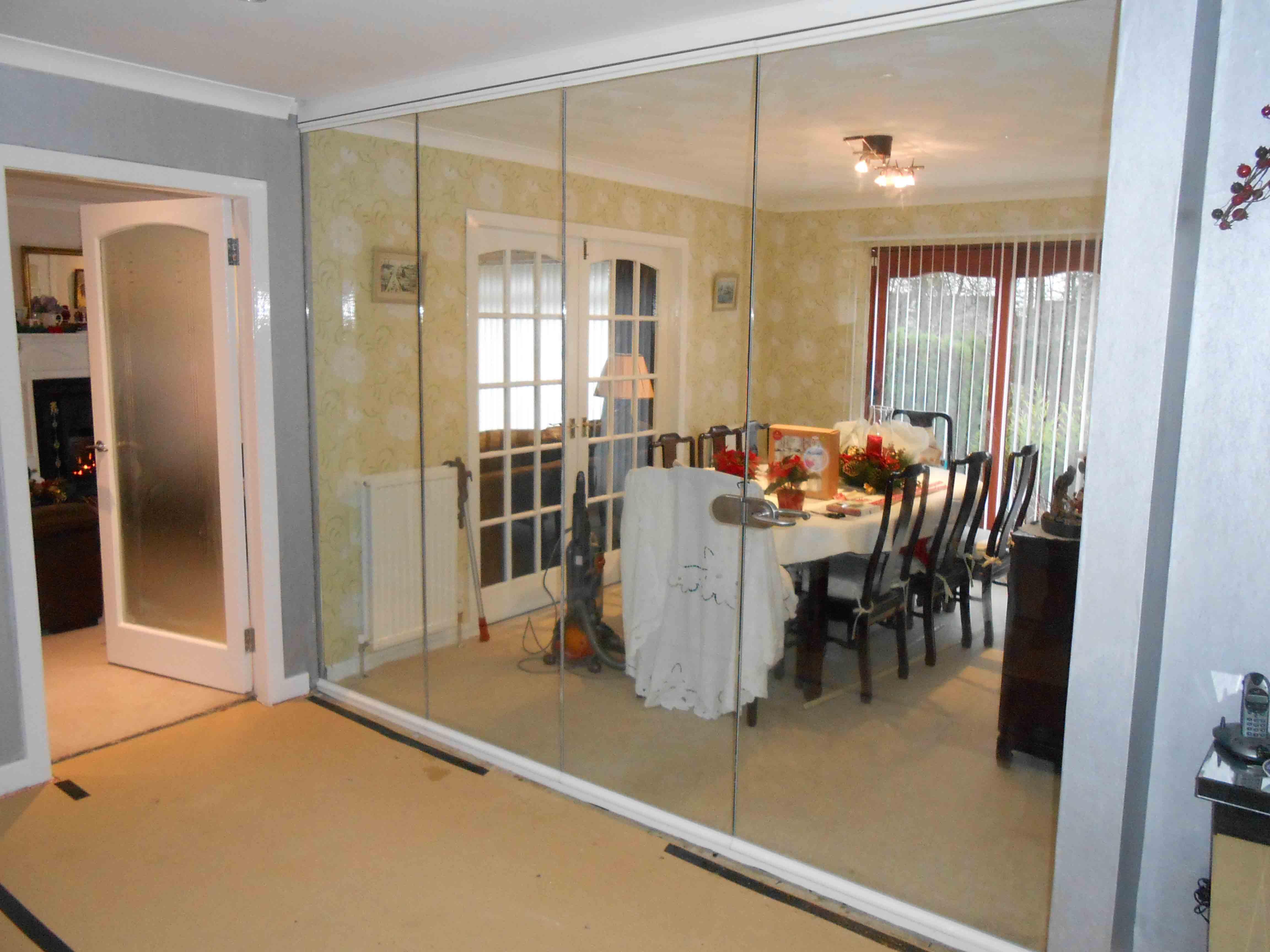 low level room dividers rotating tv stand gallery image glasgow frameless room divider frameless glass bi fold doors