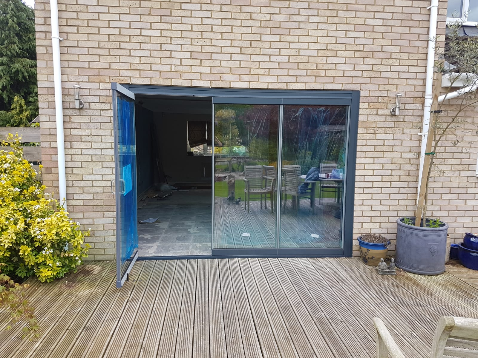 Northamptonshire 3 Panel Slide Fold Patio Doors Frameless Glass